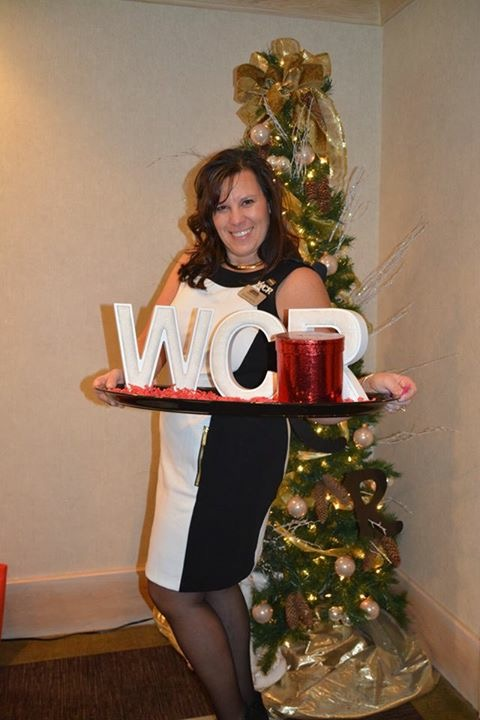 Renee being ultimate host at WCR Holiday Luncheon 2015