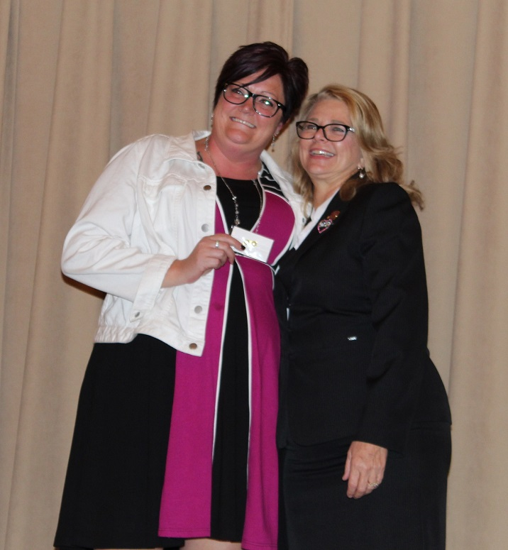 Angie Travis 2018 President receiving her PMN designation