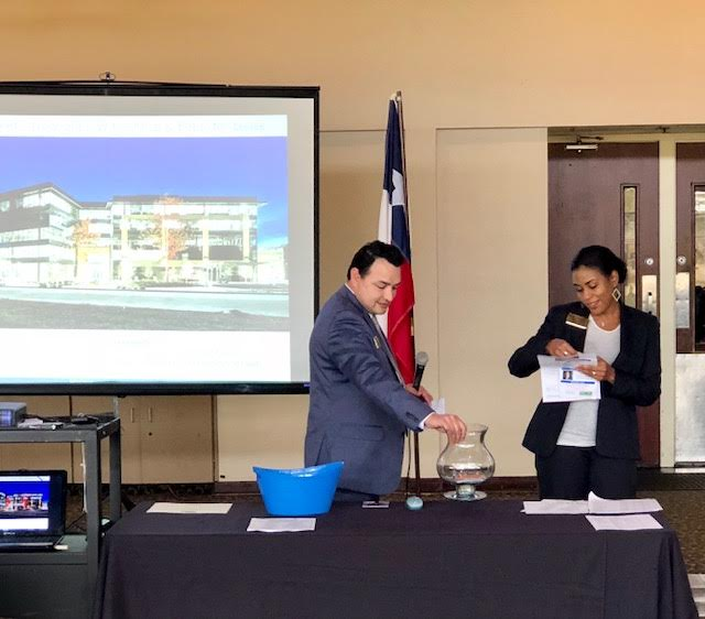 Osvaldo Chavez & Mia Kathy draw for door prizes from Better Homes & Gardens Gary Greene and Walden Country Club #1
