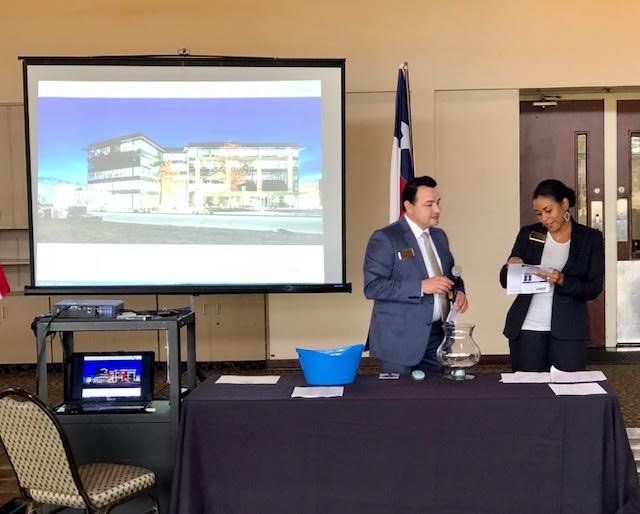 Osvaldo Chavez & Mia Kathy draw for door prizes from Better Homes & Gardens Gary Greene and Walden Country Club #2